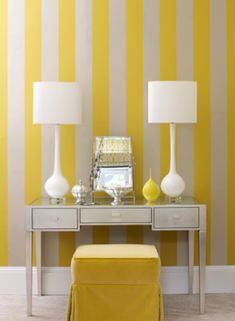 I love this vanity space. The stark white and lemon yellow striped wallpaper immediately brightens the space and adds an element of fun. The mirrored vanity and tailored ottoman keeps the space elegant and chic. Paint Stripes, Yellow Stripes, Yellow Accents, Wide Stripes, Feng Shui Colores, Yellow Home Offices, Yellow Office, Yellow Bedding, Striped Walls