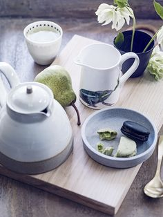 Contemporary ceramics and wooden accessories. Homes & Gardens, July 2015. Styling Sally Conran. Photographs Simon Bevan. http://www.hglivingbeautifully.com/2015/06/06/the-garden-room/