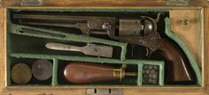 """Boxed Colt and Flask Set Presented to John Sappington Marmaduke, C.S.A. ,36 caliber, 7.5"""" barrel, serial number 2775, barrel address Col. Colt London. Colt patent markings on the left side of frame. Iron backstrap and trigger guard. British proofs on cylinder. Walnut grips. Oak case with green lining. Cased set complete with flask, mold and nipple wrench. There is a spurious silver disc on the lid of the case inscribed From the Citizens of St. Louis to General J. S. Marmaduke C.S.A…"""