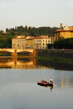 """ Sailing in the Arno river (by Mavroudakis Fotis) Florence, Tuscany, Italy """