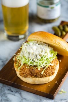 Popular Ebi Katsu Burger is made of succulent shrimp wrapped in a crispy panko shell, topped with thinly sliced cabbage, homemade tartar sauce, inside soft brioche buns. Easy Japanese Recipes, Japanese Dishes, Japanese Food, Asian Recipes, Hawaiian Recipes, Baked Shrimp Recipes, Seafood Recipes, Cooking Recipes, Cookbook Recipes