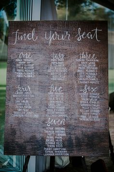 Cute calligraphy on this rustic, wooden wedding reception seating chart| Image by LiFe Photography