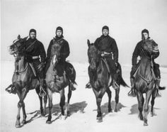Members of a Coast Guard Horse Patrol unit that patrolled beaches in the New Jersey area during World War II. Left to right: Seamen first class C. R. Johnson, Jesse Willis, Joseph Washington, and Frank Garcia.