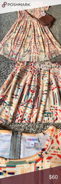 🆕LulaRoe Amelia🆕 Brand new with tags beautiful LulaRoe Amelia! Size 3xl fits 24-26. Cream background with a beautiful coral/turquoise/purple Aztec overlay. Feel free to ask me any questions!  🌿 Check out my closet for more! Bundle to save! Trades accepted. 🌿 LuLaRoe Dresses Midi