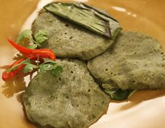 Steamed Moong Cheela Recipe - Ground whole moong spread between two banana leaves and steamed.