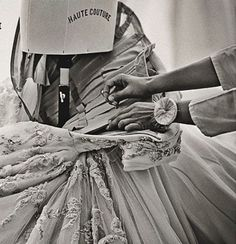 """""""A seamstress to finish up a model of Christian Dior Haute Couture collection. In fashion are often the details that make the difference."""" Text & image via the beautiful Italian blog ogniricciouncapriccio"""