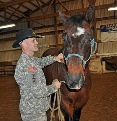 """ON PARADE — Three horses from Freedom Stables, home of the nonprofit AT EASE equine therapy program for disabled veterans, will be among the """"first wave"""" of entries in the inaugural parade Jan. 21, 2012. Shown at left is Mike Olson, commander of Fort Atkinson's Wisconsin Army National Guard unit, Alpha Troop of the 105th Cavalry, with Zippy, one of the horses that is slated to participate in the parade. — Daily Union photo by Pam Wilson. Click for article."""