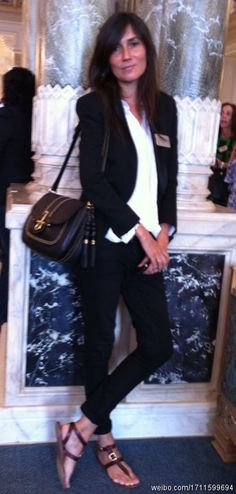 Emmanuelle Alt. The only picture of her I have ever seen in flats.