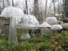 Glitzy DIY garden art- Mushrooms / Toadstools of all sizes made from cut glass bowls and vases.
