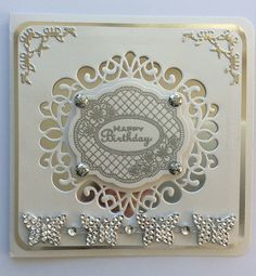 Scandinavia collection - Stockholm from Creative Expressions with matching Camellia Trellis stamp which was embossed then cut with the original die. Corner dies from Rob Addams set of four Finishing Touches dies. New from All Occasion dies. The butterflies along the bottom are on a roll from The Range.