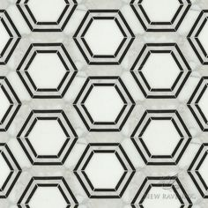 Pembroke, a waterjet stone mosaic, shown in Calacatta Tia, Thassos and Nero Marquina honed, is part of the Silk Road Collection by Sara Baldwin for New Ravenna Mosaics. <br /> <br /> Take the next step: prices, samples and design help, http://www.newravenna.com/showrooms/
