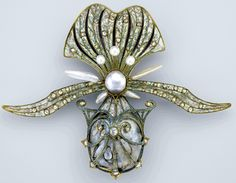 Georges Fouquet (French, 1862–1957), orchid brooch, 1901, gold, enamel, diamond and pearl; Museum of Fine Arts, Boston, lent by a private collection. —Photograph ©Museum of Fine Arts, Boston