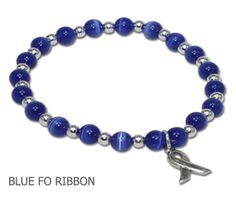 Colon Cancer awareness bracelet with blue Cat's Eye beads and sterling silver or pewter awareness ribbon from A Different Twist Awareness Jewelry