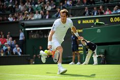 Andy Murray chases a backhand return.