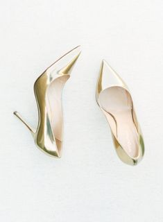 Gold pointed toe Sergio Rossi pumps: Photography: Kristina Adams Photography - www.kristinaadamsphotography.com   Read More on SMP: http://www.stylemepretty.com/2017/01/18/dolce-gabbana-inspired-wedding/
