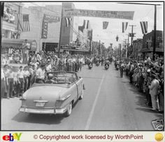 """30 Apr 1951 General Douglas MacArthur visited Murfreesboro, Tennessee! In the first pic above you can see a banner over the street in the parade that reads """"Welcome General - Jean - Arthur"""" with """"Committee HDQ"""" in the upper right corner! I have been told that this is welcoming General MacArthur himself, his wife """"Jean"""", and their son """"Arthur""""! You can see that t are Lots of flags, and the streets are Lined with folks out to see the General and the parade!"""