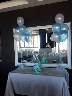 Table arrangements in pale blue, azure blue and white for the cake table