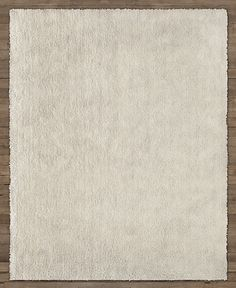 RH Baby & Child's Moda Shag Rug:Hand tufted from long, silky yarns, this classic shag rug puts a plush layer under little feet. The durable pile echoes the soft feel and long wear of wool, and each rug is carefully finished with an even, sheared surface and hand-hemmed edges.