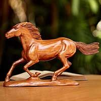 Wood statuette, 'Wild Beauty'. Shop from #UNICEFMarket and help save the lives of children around the world.