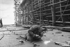 welder working at a shipyard in Greenock on 17 July 1954. There is ...