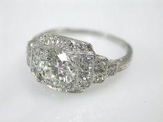 One platinum art deco ring. One round brilliant cut diamond (1.05 carat diamond: VS1 clarity: I-J colour). Twenty single cut diamonds (VS-SI clarity: H-I colour).