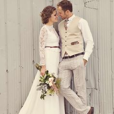 Boho wedding idea - bride in long sleeve lace gown and groom in tan slacks and vest with plaid details {Renaissance Studios Photography}