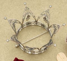 Norwegian Wedding Crown with small spoon-shaped bangles. When the bride moves her head the bangles produce a melodic tinkling music. Norwegian tradition holds that the music from the bride's bangles will ward off evil spirits.