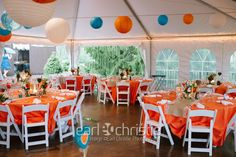 orange and teal hanging wedding lanterns Wickham Park.                  Paper lanterns for sale: http://www.tradesy.com/weddings/wedding-decorations/various-paper-lanterns-558175