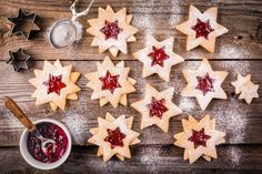 Christmas Linzer cookies with raspberry jam by nblxer. Christmas Linzer cookies with raspberry jam on a rustic wooden background Christmas Mood, Christmas Candy, Christmas Baking, Meringue Cookies, Galletas Cookies, Cookies Et Biscuits, Holiday Cookies, Winter Time, Decorated Cookies