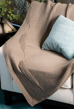 Knitting Pattern for Feather Throw - This easy afghan features an elegant eagle feather motif down the side. Quick knit in bulky yarn.