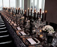 Dress a single long table with black and white damask linens, silver square chargers and crystal candelabrum with black taper candles – so chic!