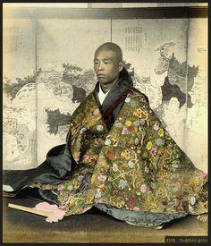 Richly embroidered sad (or bored) priest, ca. 1890 attr. to Seibei Kajima