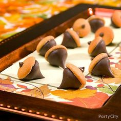 "Put together chocolate kisses and wafer cookies to make adorable ""acorns!"""