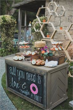 All you need is love... And maybe some candy/coffee/ donuts/ etc. ;) | love the flowers on the table too