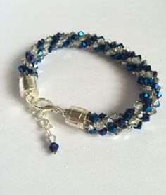 Items similar to Crystal kumihimo braided bracelet with blue and metallic silver bicone beads on Etsy Braided Bracelets, Gifts For Her, Braids, My Etsy Shop, Crystals, Creative, Handmade, Stuff To Buy, Shopping