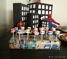 Adorable way to display marshmallow pops at a superhero party! #kidsparty