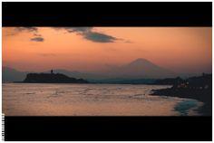 Sunset over the Mount Fuji seen next to Enoshima Island, from the beach along the Shonan shore.  Kamakura - Japan