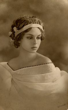 I know nothing about the woman in this old photograph; but isn't she lovely?