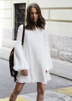 White and romantically chic dress