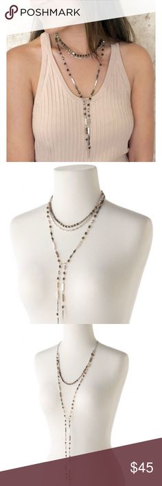 """Stella & Dot Amelie Lariat Necklace BRAND NEW Stella & Dot Amelie Lariat Necklace-- brand new WITHOUT tags/box.                                                     Wear this mixed metal and semi-precious labradorite strand as a stations necklace at two different lengths, as an open wrap style, or use either the silver strand or mixed metal strand to create a tied lariat.  Mixed Metal Plating 48 1/2"""" Length Stella & Dot Jewelry Necklaces"""