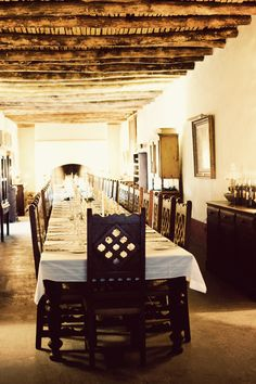 A Texas dining room with old world Mexico and Spanish vibes. Wow.