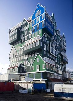 "Netherlands - The Zaandam Inntel -  ""This unusual hotel near Amsterdam was designed by architect Wilfried van Winden, has now been open a little over two years. Overall, it resembles cleverly interconnected and stacked traditional Zaans cottages, usually green. The blue section, in one top corner of the twelfth floor, pays homage to one of the several studies of the town, painted by Claude Monet in 1871."