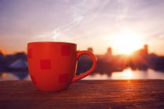 Red coffee cup sunrise