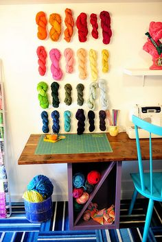 I love the idea of displaying yarn on the wall for color inspiration, storage, and ease of access.