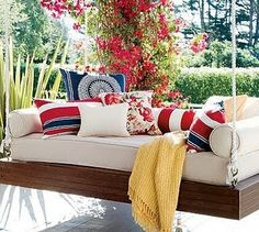 Love the vines and the extra large porch swing