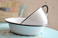 Perfect set of vintage white and black enamelware. Set includes a coffee cup and small bowl. The enamelware has some age/rust spots (shown in