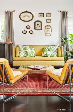 Midcentury living room with yellow sofa and mustache art gallery wall