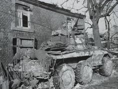 M8 Greyhound armored car of the 4th Cavalry Squadron, 4th Cavalry Group (attached to 2nd Armored Division) at Borzée, Belgium, January 16, 1945.
