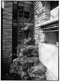 55. DETAIL OF NATURAL BOULDER, THREE-STORY WINDOW AND STONE CHIMNEY FROM WEST TERRACE. - Fallingwater, State Route 381 (Stewart Township), Ohiopyle, Fayette County, PA