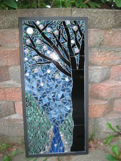 Mosaic Tree next to a stream